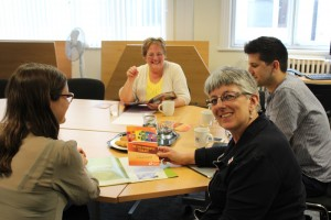 Ruth Holtom with MEP Julie Ward and members of her team discussing the social and solidarity economy